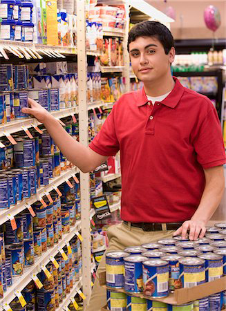 Young man with spina bifida working as grocery stocker
