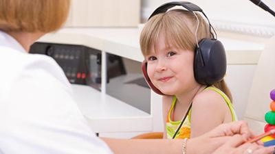 Elementary child with headphones