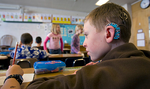 Young student with hearing aid