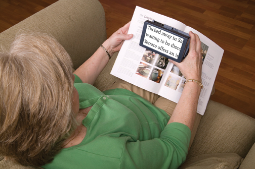 Elderly Woman Using Magnifier