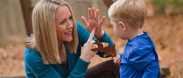 Mom and young boy using sign language