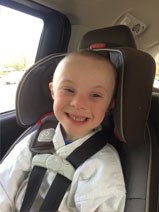 Boy with Down Syndrome in Carseat