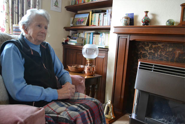 Elderly woman sitting in home